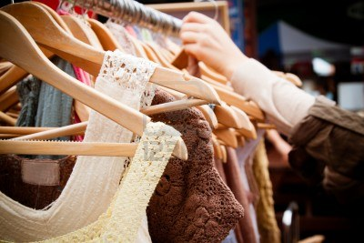 13899112-a-rack-of-second-hand-women-dresses-at-a-market-in-london-recession-bargains